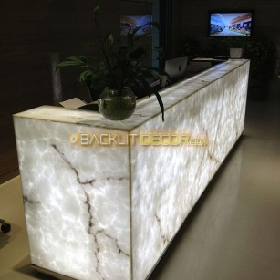 Fully illuminated reception desk.