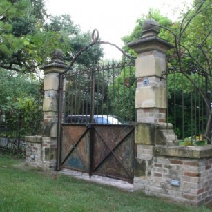 Antique gate and masonry surround in a new setting.
